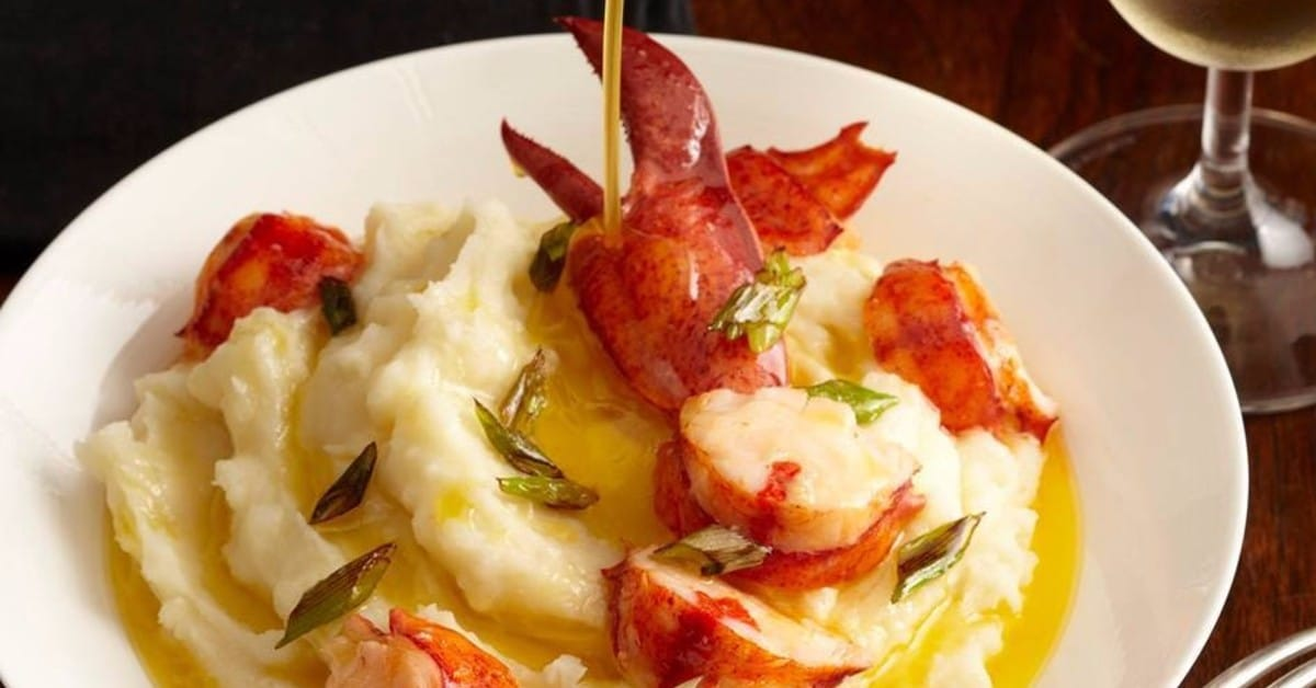 Lobster Night mashed potatoes, drawn butter and scallops.
